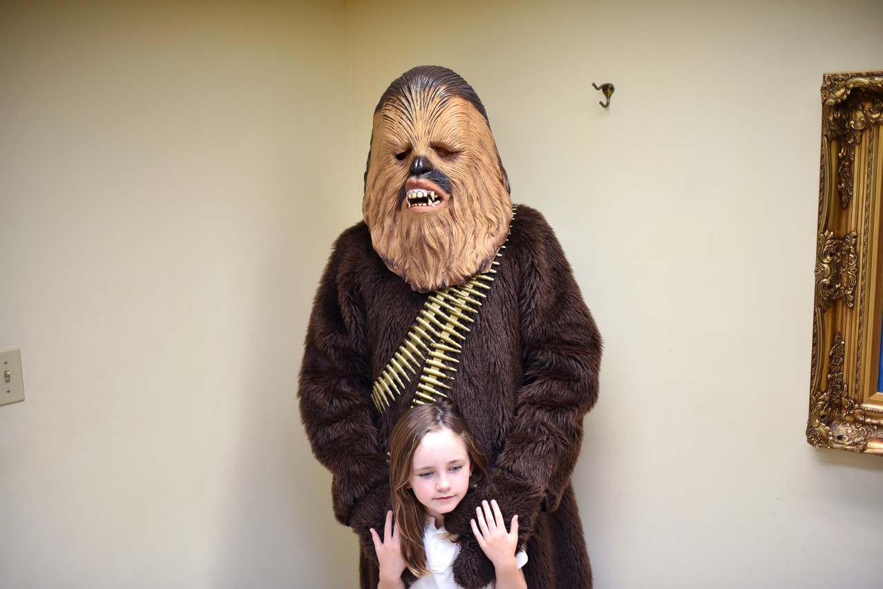 kalyssa sullivan 5 leans against her chewbacca clad father john sullivan 45 in the creatures of habit costume shop in paducah halloween is just a few